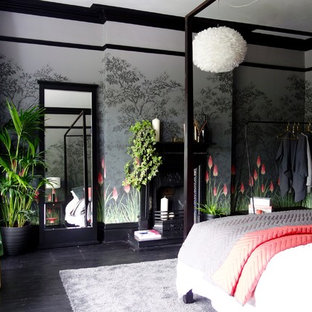 Inspiration for a medium sized bohemian guest bedroom in Other with multi-coloured walls, painted wood flooring, a standard fireplace, a metal fireplace surround and black floors.