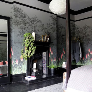Bedroom - mid-sized eclectic guest painted wood floor and black floor bedroom idea in Other with multicolored walls, a standard fireplace and a metal fireplace