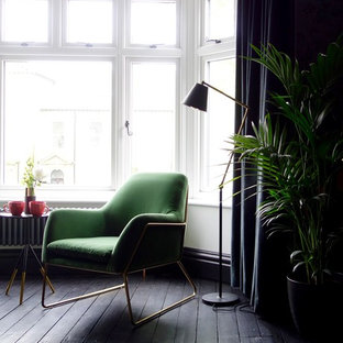 Inspiration for a mid-sized eclectic guest bedroom in Other with multi-coloured walls, painted wood floors, a standard fireplace, a metal fireplace surround and black floor.
