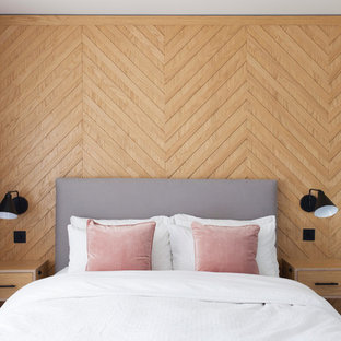 Photo of a scandinavian bedroom in London with beige walls and no fireplace.