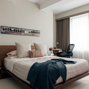 Example of a 1960s medium tone wood floor bedroom design in New York with beige walls