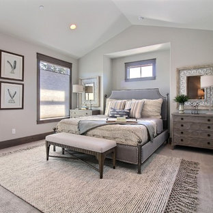 Photo of an expansive arts and crafts guest bedroom in Portland with grey walls, carpet and beige floor.