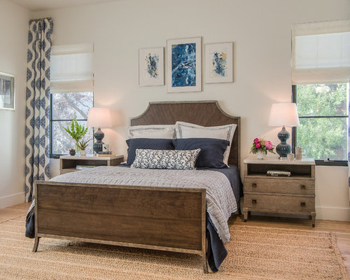 example of a large transitional master light wood floor and brown floor bedroom design in dallas - Master Bedroom Design Ideas