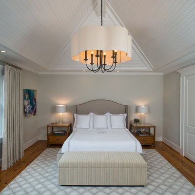 Bedroom - large traditional master light wood floor bedroom idea in Houston with gray walls and no fireplace