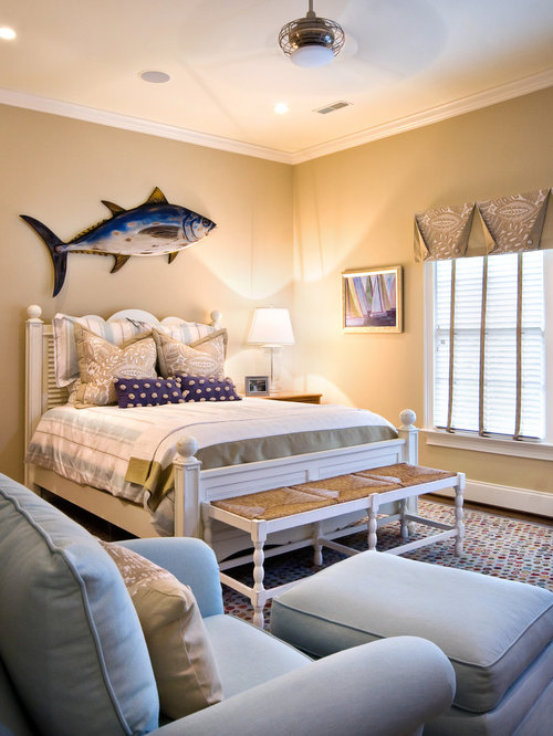 Example Of A Large Coastal Guest Dark Wood Floor And Brown Bedroom Design In Charleston