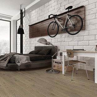 Ejemplo de dormitorio tipo loft, nórdico, de tamaño medio, sin chimenea, con paredes blancas y suelo de madera en tonos medios