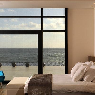 Trendy bedroom photo in Other with beige walls