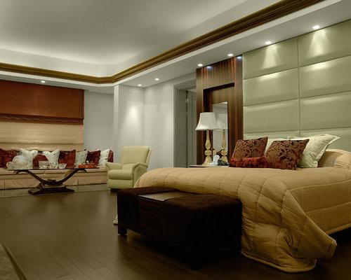 dark wood floor bedroom idea in other with white walls