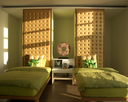 Inspiration for a contemporary guest medium tone wood floor bedroom remodel  in Other with green walls