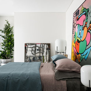 This is an example of an eclectic master bedroom in Perth with white walls, concrete floors and grey floor.