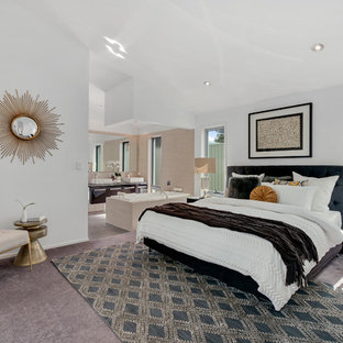 Inspiration for a mid-sized contemporary master bedroom in Gold Coast - Tweed with white walls, carpet and grey floor.