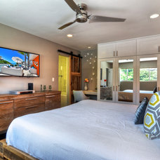 Tropical Bedroom by James Glover Residential & Interior Design