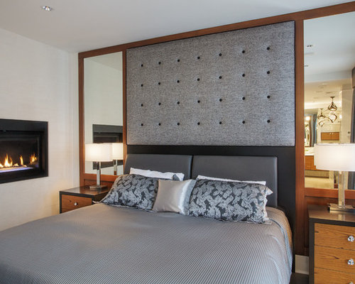 Contemporary bedroom idea in Vancouver with white walls