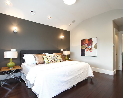 Example of a trendy dark wood floor bedroom design in Vancouver with gray  walls