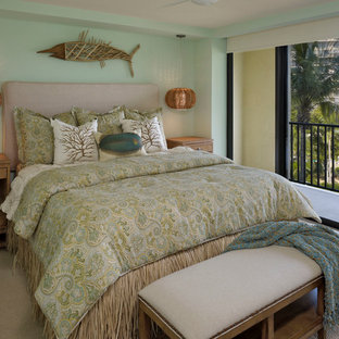 Bedroom - coastal carpeted bedroom idea in Tampa with green walls