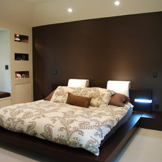 Modern Bedroom by M. Designs Architects