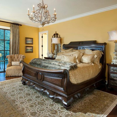 Inspiration for a large mediterranean master dark wood floor bedroom remodel in Other with yellow walls