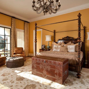 Inspiration for a large mediterranean dark wood floor and brown floor bedroom remodel in Other with yellow walls