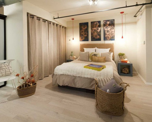Eclectic loft-style bedroom idea in Los Angeles with beige walls and ...