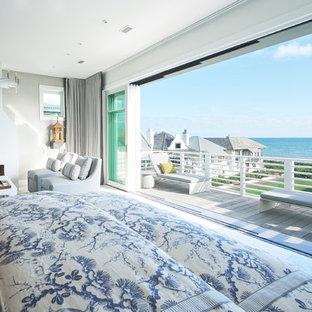 На фото: большие хозяйские спальни в морском стиле с серыми стенами, мраморным полом, стандартным камином, фасадом камина из штукатурки и серым полом