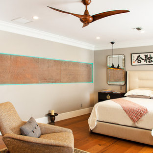 Inspiration for a large eclectic master brown floor and medium tone wood floor bedroom remodel in Raleigh with gray walls and no fireplace