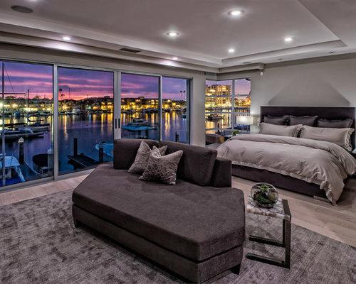 bedroom large contemporary master light wood floor and beige floor bedroom idea in orange county - Contemporary Master Bedroom Ideas