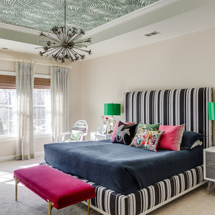 Example of a large eclectic master carpeted and beige floor bedroom design in DC Metro with beige walls and no fireplace