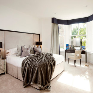Contemporary bedroom in Manchester with white walls, carpet and beige floors.