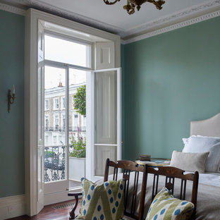Inspiration for a large victorian master bedroom in London with green walls, brown floor and medium hardwood floors.