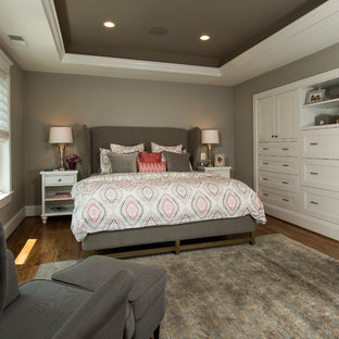 Large transitional master medium tone wood floor and brown floor bedroom photo in DC Metro with gray walls and no fireplace