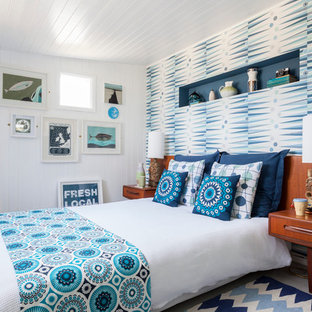 Coastal painted wood floor bedroom photo in London with white walls