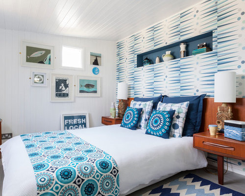 Coastal Bedroom Photo In London With White Walls And Painted Wood Floors