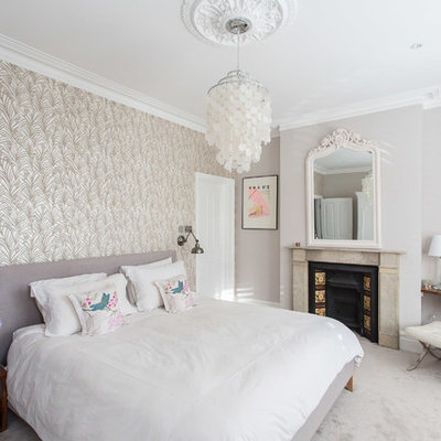 Bedroom - mid-sized contemporary master carpeted bedroom idea in London with gray walls, a standard fireplace and a stone fireplace