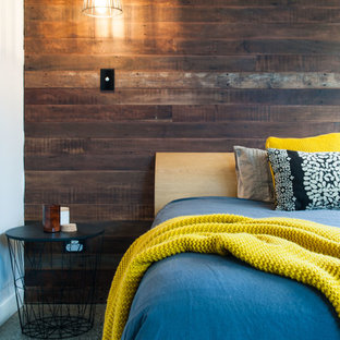 Inspiration for a mid-sized contemporary guest bedroom in Brisbane with white walls, concrete floors and no fireplace.
