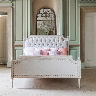 Elegant master limestone floor bedroom photo in Sussex with green walls