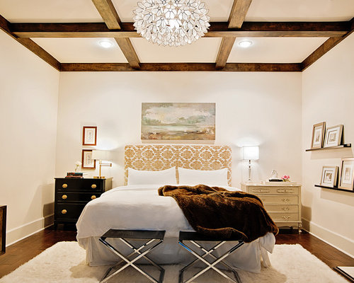 example of a trendy dark wood floor bedroom design in dallas with beige walls
