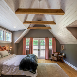 Inspiration for a country master bedroom in Philadelphia with grey walls, medium hardwood floors and brown floor.
