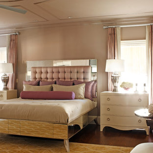Inspiration for a large timeless master medium tone wood floor bedroom remodel in Atlanta with black walls
