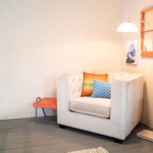 Example of a small eclectic loft-style painted wood floor and blue floor bedroom design in Albuquerque with beige walls