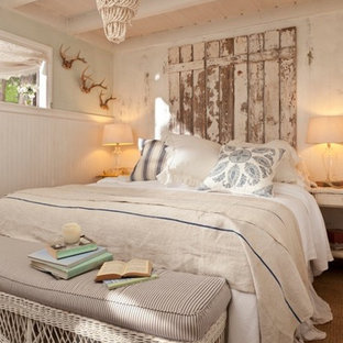 Inspiration for a traditional bedroom in Los Angeles with beige walls.