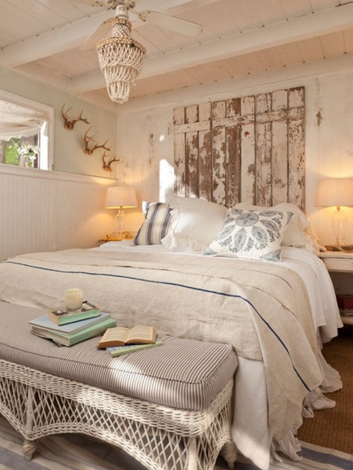 Inspiration for a shabby-chic style bedroom remodel in Los Angeles with  beige walls