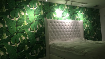 vintage wall-covering installation and flamingo wallpaper