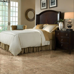 Design ideas for a mid-sized traditional guest bedroom in Other with brown walls, no fireplace, vinyl floors and brown floor.