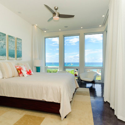Island style master bedroom photo in Miami with white walls