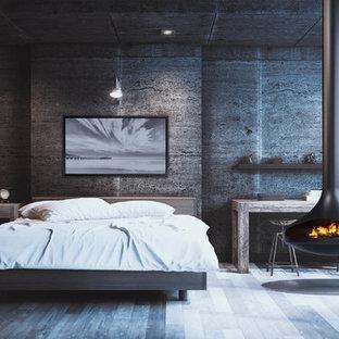 Foto di una camera da letto contemporanea con camino sospeso
