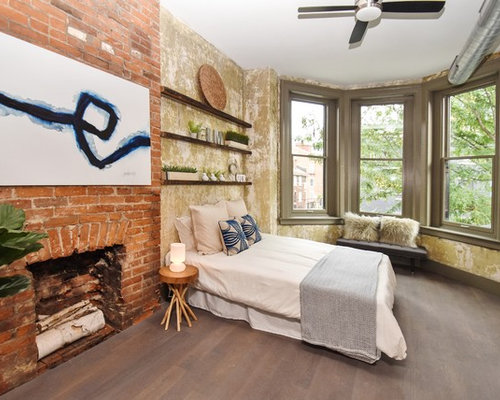 urban bedroom photo in cincinnati with a standard fireplace and a brick fireplace surround