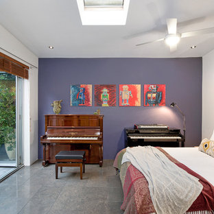 Eclectic guest bedroom in Sydney with purple walls, grey floor and porcelain floors.