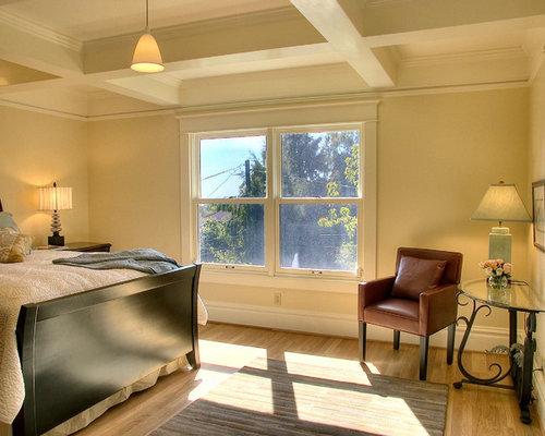 Elegant Light Wood Floor Bedroom Photo In Seattle With Beige Walls
