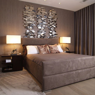 Inspiration for a contemporary bedroom remodel in Atlanta with brown walls