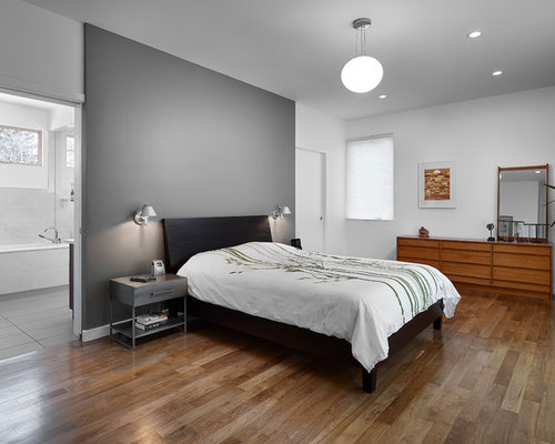 Inspiration for a large 1950s master bedroom remodel in Edmonton with  medium tone hardwood floors, - Grey Wall Houzz